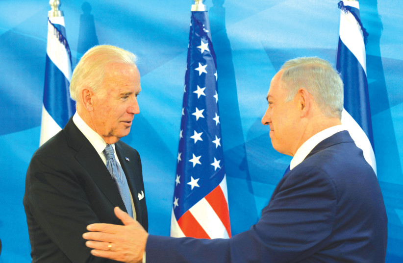 THEN-US vice president Joe Biden embraces Prime Minister Benjamin Netanyahu in Jerusalem in 2016. (photo credit: AMOS BEN-GERSHOM/GPO)