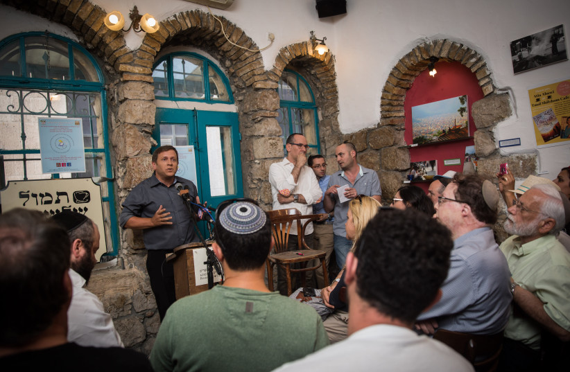 Israeli actor, director, playwright, and acting teacher, Hagai Luber, speaks during an artists' conference in Tmol Shilshom Cafe in Jerusalem (photo credit: HADAS PARUSH/FLASH90)