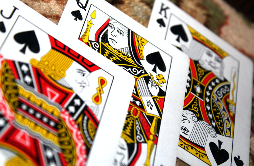 King, Queen and Jack playing cards (photo credit: PEXELS)