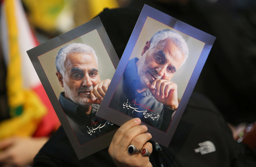 A supporter of Lebanon's Hezbollah leader Sayyed Hassan Nasrallah carries pictures of the late Iran's Quds Force top commander Qassem Soleimani during a rally commemorating the annual Hezbollah's slain leaders in Beirut's southern suburbs, Lebanon February 16, 2020 (credit: REUTERS/AZIZ TAHER)