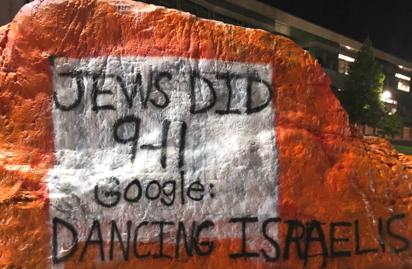 Antisemitism in the United States: Antisemitic graffiti on The Rock landmark at the University of Tennessee in Knoxville, blaming Jews for the September 11, 2001 terrorist attacks, September, 2019 (photo credit: ADL)