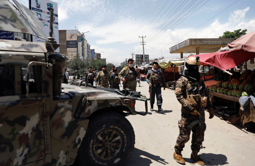 Afghan security forces arrive at the site of an attack in Kabul (photo credit: REUTERS)