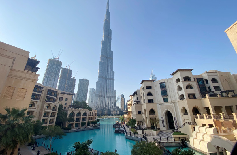 A general view shows the area outside the Burj Khalifa, the world's tallest building, mostly deserted, after a curfew was imposed to prevent the spread of the coronavirus disease (COVID-19), in Dubai, United Arab Emirates March 25, 2020. Picture taken March 25, 2020 (photo credit: REUTERS/TAREK FAHMY)