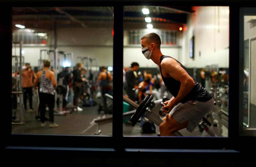 Fitness studio reopens following weeks of closure due to global outbreak of the coronavirus disease (photo credit: REUTERS)