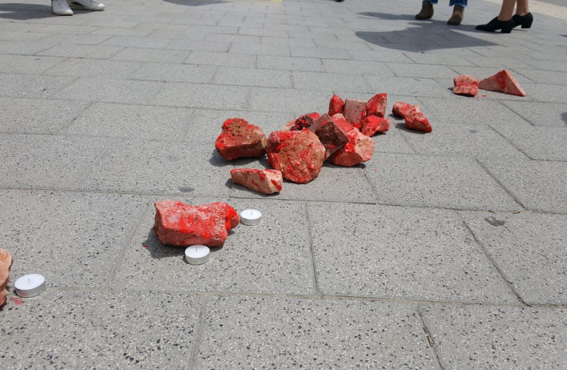 Rocks, painted in red, outside the IDF HQ in Tel Aviv during a protest against army anti-terror policy. Protesters wanted to show that stone-throwing can kill  (photo credit: IM TIRTZU)