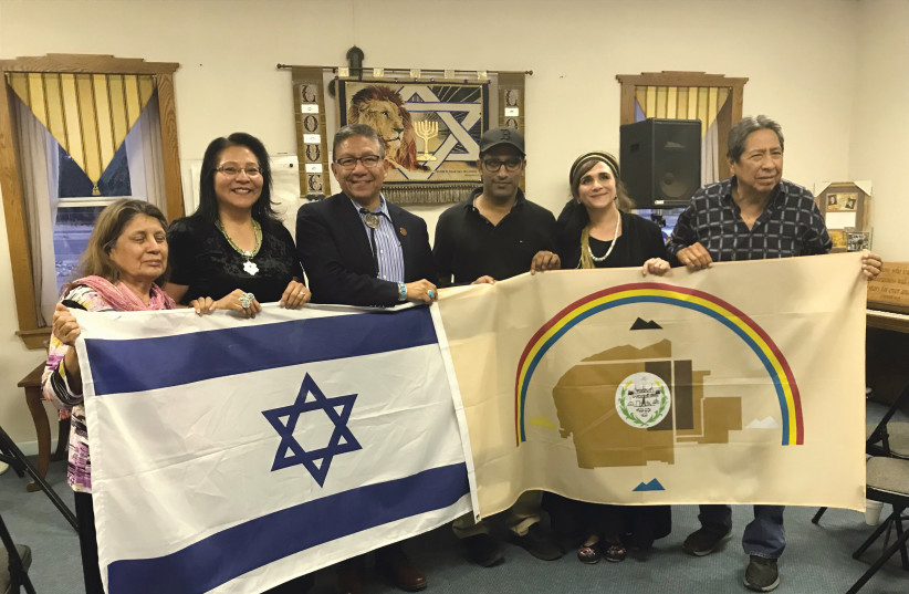 NAVAJO NATION vice president Myron Lizer (third from left), Dine Navajo Nation members and Indigenous Bridges activists including Ateret Violet Shmuel (second from right) hold the Navajo Nation and Israeli flags to demonstrate the desire to collaborate. (photo credit: Courtesy)
