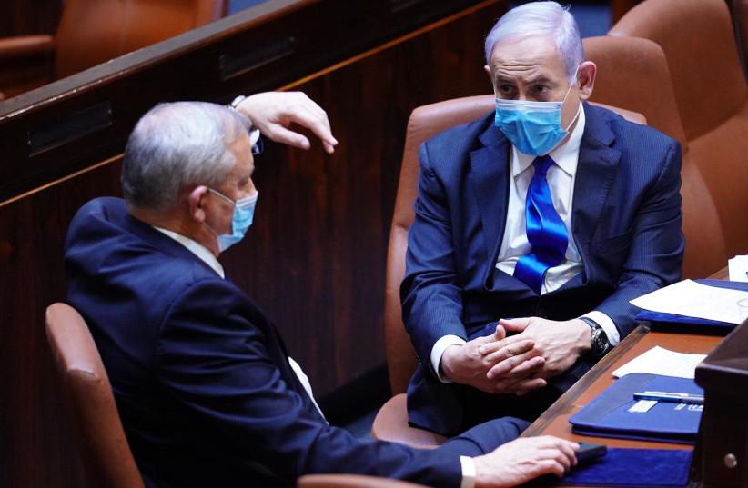 Defense Minister Benny Gantz [L] and Prime Minister Benjamin Netanyahu [R] wearing masks in the Knesset (photo credit: ADINA VALMAN/KNESSET SPOKESPERSON)