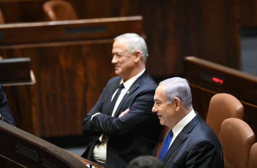 Prime Minister Benjamn Netanyahu and Defense Minister Benny Gantz at the swearing in of the new government (photo credit: AMOS BEN-GERSHOM/GPO)
