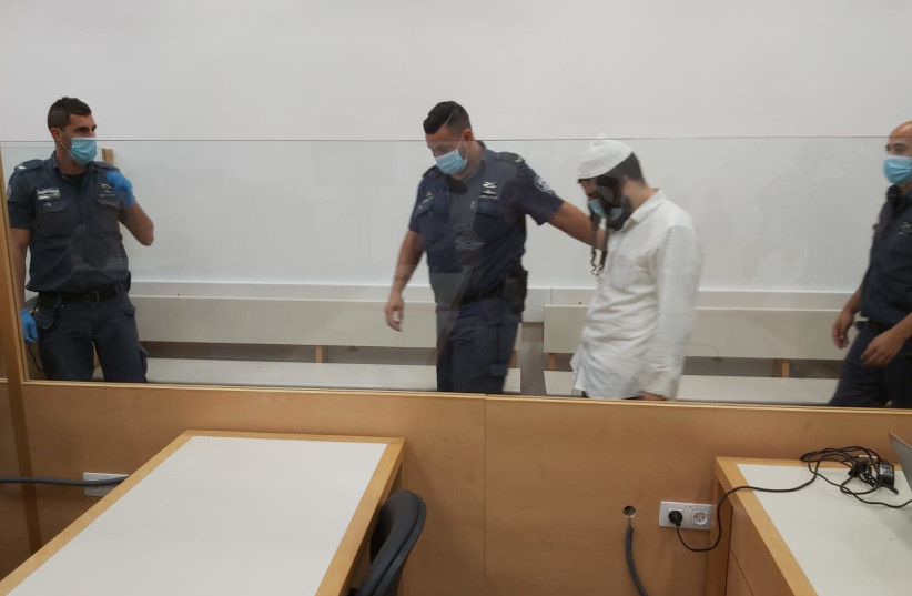 Amiram Ben-Uliel appears at Lod District Court ahead of his conviction in the Duma arson case, May 18, 2020 (photo credit: YONAH JEREMY BOB)