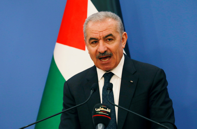Palestinian Prime Minister Mohammad Shtayyeh speaks before the start of the weekly cabinet meeting in Ramallah, West Bank May 11, 2020 (photo credit: REUTERS/MOHAMAD TOROKMAN)