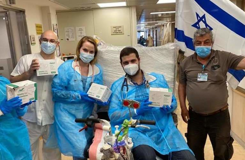Hospital staff with masks Miriam Lottner bought in China (Credit: Masks for Israel) (photo credit: Courtesy)