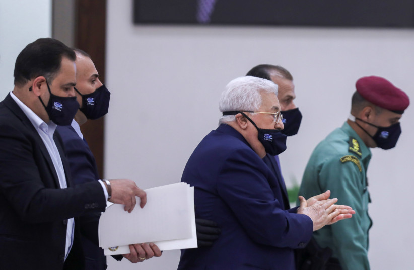 Palestinian Authority President Mahmoud Abbas wears a protective face mask during a leadership meeting in Ramallah on May 19, 2020 (photo credit: REUTERS)