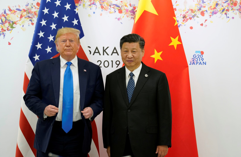 US PRESIDENT Donald Trump and Chinese President Xi Jinping stand side by side at the G20 leaders summit in Japan last year (photo credit: KEVIN LAMARQUE/REUTERS)