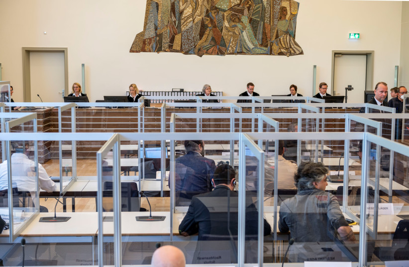 Trial of members of Syrian President Bashar Assad's security services for crimes against humanity in Germany last month (photo credit: REUTERS/THOMAS LOHNES)
