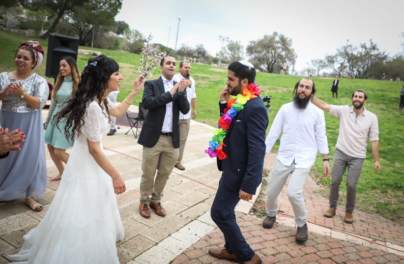 HANANEL EVEN HEN and Shiran Habush celebrate during their corona-era wedding at an Efrat public park on March 15. Jerusalem and its destruction have been remembered at weddings by Jews throughout the world for 2,000 years (photo credit: GERSHON ELINSON/FLASH90)