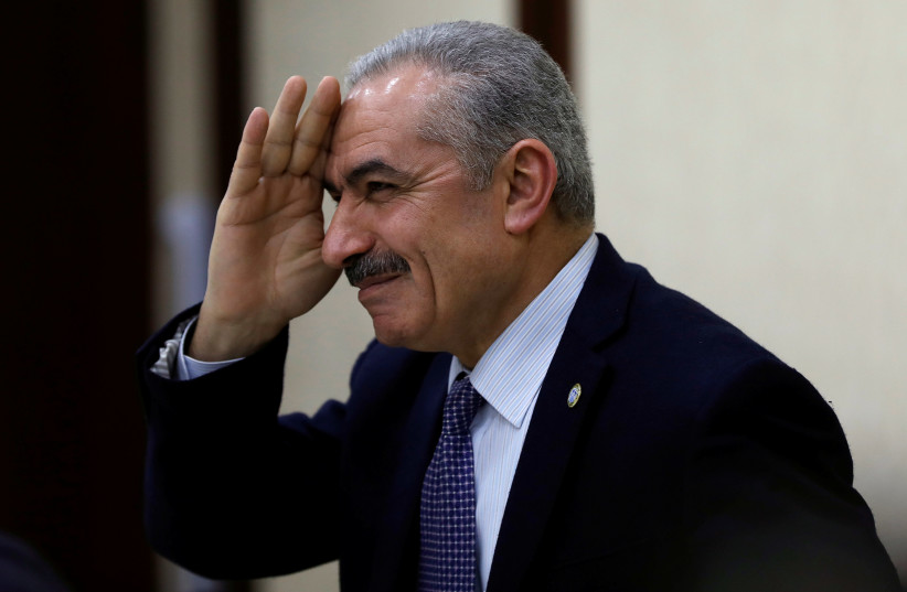 Senior Fatah official Mohammed Shtayyeh gestures during a Palestinian leadership meeting in Ramallah, in the West Bank February 20, 2019 (photo credit: REUTERS/MOHAMAD TOROKMAN)