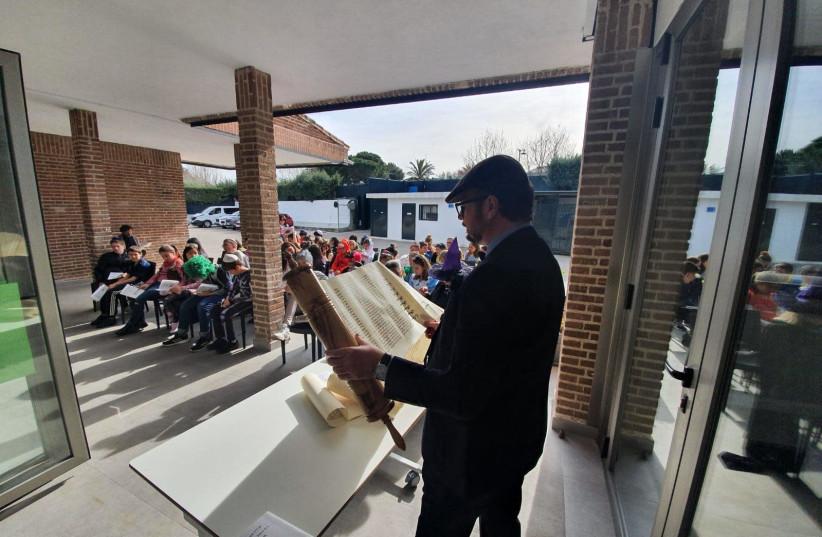 Megilla reading at the Jewish School in Madrid the day before the school closed for the coronavirus (photo credit: COURTESY OF RABBI PIERPAOLO PUNTURELLO)