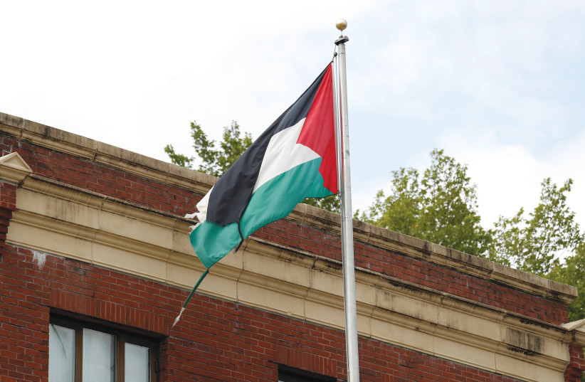 THE PALESTINIAN flag flies at a Palestinian Authority diplomatic post. (photo credit: REUTERS)