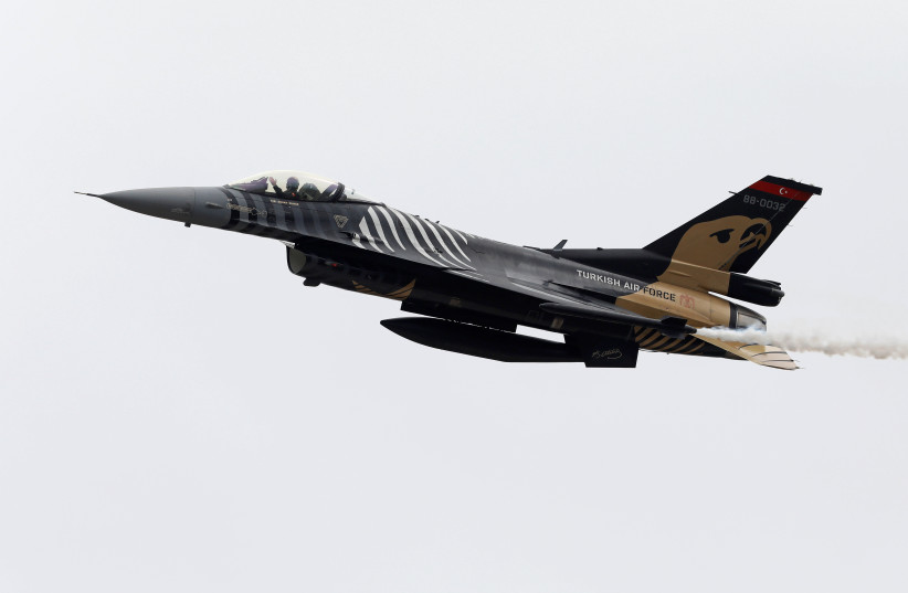 Turkish Air Force pilot gestures as he flies F-16C during the Pakistan Day military parade in Islamabad, Pakistan, March 23, 2019 (photo credit: REUTERS/AKHTAR SOOMRO)