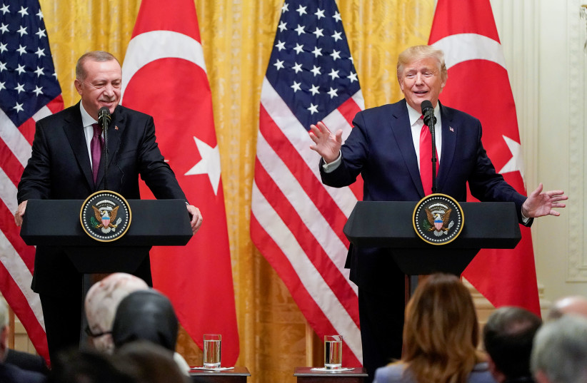 US President Donald Trump speaks next to Turkey's President Tayyip Erdogan during a joint news conference at the White House in Washington, US, November 13, 2019 (photo credit: JOSHUA ROBERTS / REUTERS)