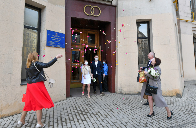 THE WEDDING is great, but in real life getting to 'happily ever after' is not always easy.  (Pictured: A newly wed couple outside a Moscow marriage registration palace) (photo credit: REUTERS)
