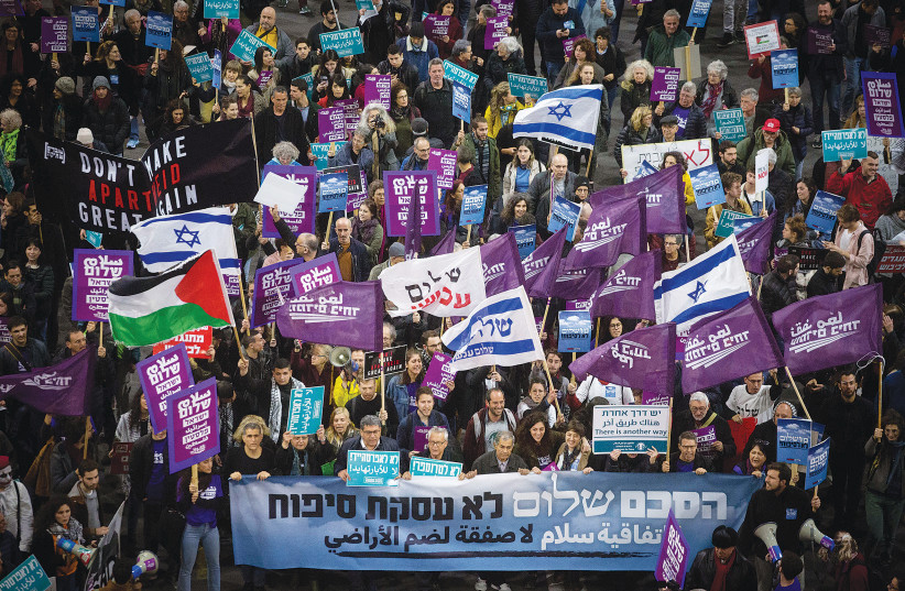 LEFT-WING ACTIVISTS demonstrate against US President Donald Trump's Middle East peace plan, in Tel Aviv last February. (photo credit: MIRIAM ALSTER/FLASH90)