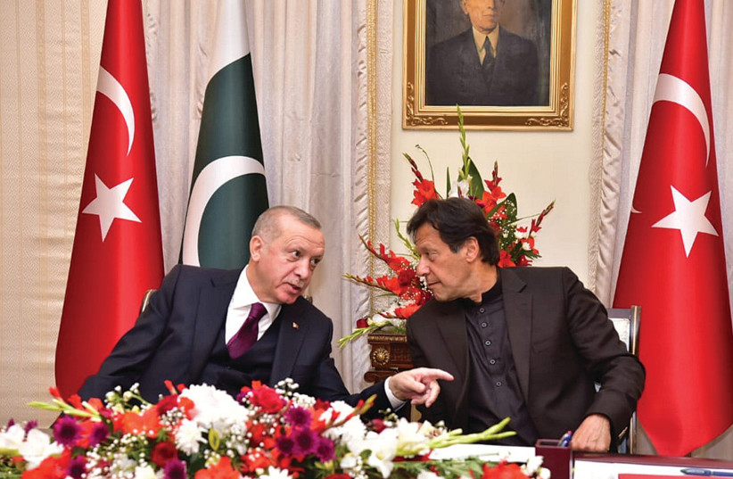 PAKISTAN'S PRIME MINISTER Imran Khan (right) and Turkish President Tayyip Erdogan speak during an agreement signing ceremony in Islamabad, in February. (photo credit: REUTERS)