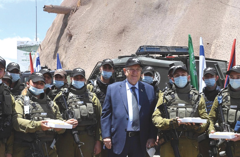 PRESIDENT REUVEN RIVLIN gives cheesecake and cold lemonade to soldiers from the Erez Brigade. (photo credit: MARK NEYMAN/GPO)