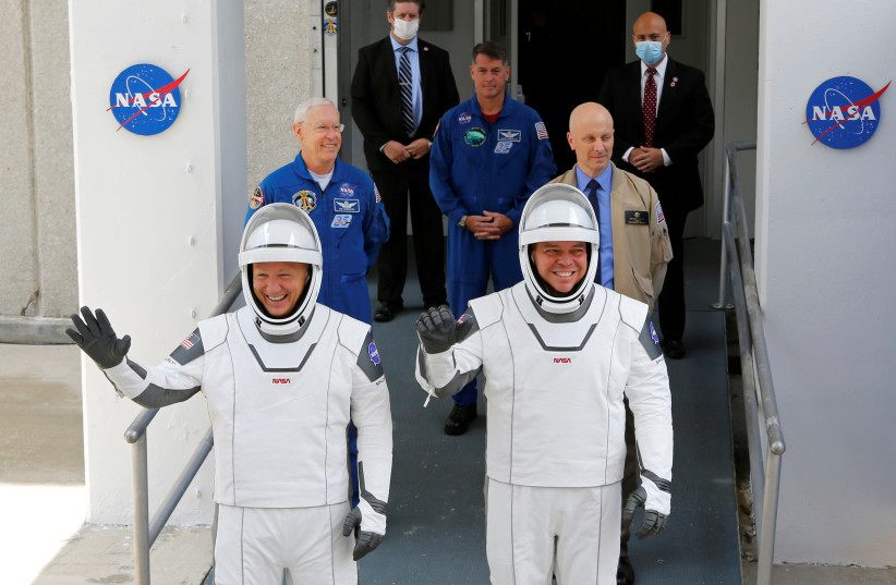 NASA astronauts Douglas Hurley and Robert Behnken head to Pad39A before the launch of a SpaceX Falcon 9 rocket and Crew Dragon spacecraft at the Kennedy Space Center, in Cape Canaveral, Florida, U.S., May 27, 2020 (photo credit: REUTERS/JOE SKIPPER)