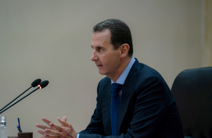 Syrian President Bashar al-Assad addresses the government committee that oversees measures to curb the spread of the coronavirus disease (COVID-19), in Damascus, Syria in this handout released by SANA on May 4, 2020 (photo credit: SANA/HANDOUT VIA REUTERS)