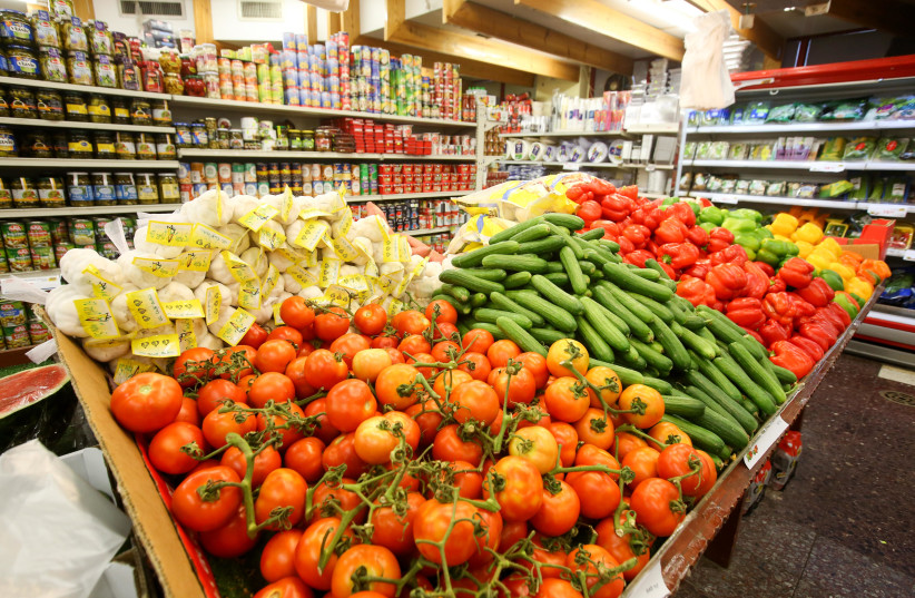 FRESH PRODUCE is stacked in a store in Jerusalem's Mahaneh Yehuda market (photo credit: MARC ISRAEL SELLEM/THE JERUSALEM POST)