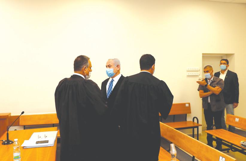 PRIME MINISTER Benjamin Netanyahu at his trial. (photo credit: REUTERS)