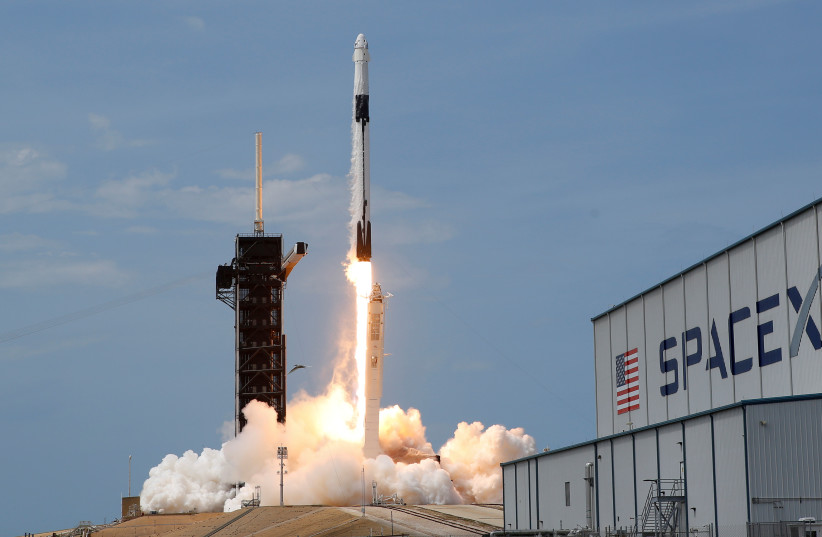 A SpaceX Falcon 9 rocket and Crew Dragon spacecraft carrying NASA astronauts Douglas Hurley and Robert Behnken lifts off during NASA's SpaceX Demo-2 mission to the International Space Station from NASA's Kennedy Space Center in Cape Canaveral, Florida, U.S., May 30, 2020. (photo credit: JOE SKIPPER/REUTERS)