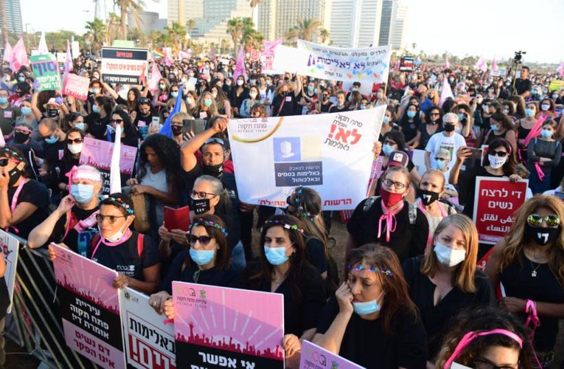 Protesters gather in Tel Aviv to protest the rising domestic violence during the coronavirus pandemic. (photo credit: AVSHALOM SASSONI/MAARIV)