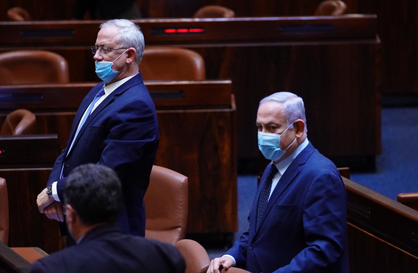 Prime Minister Benjamin Netanyahu and Alternate Prime Minister Benny Gantz arrive at the Knesset plenum to vote on four no confidence votes against the government (photo credit: KNESSET PRESS SERVICE/ADINA VALMAN)