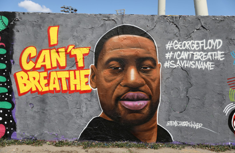A mural depicts African-American man George Floyd, who died in Minneapolis police custody, at Mauerpark in Berlin, Germany, May 30, 2020. (photo credit: REUTERS)