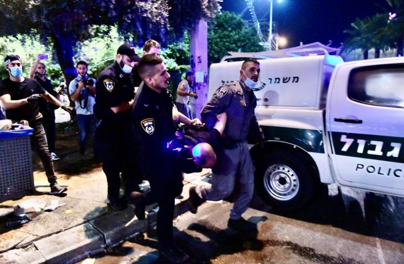 Police are seen arresting a protester at Tel Aviv's Rabin Square on June 6. (photo credit: AVSHALOM SASSONI/MAARIV)