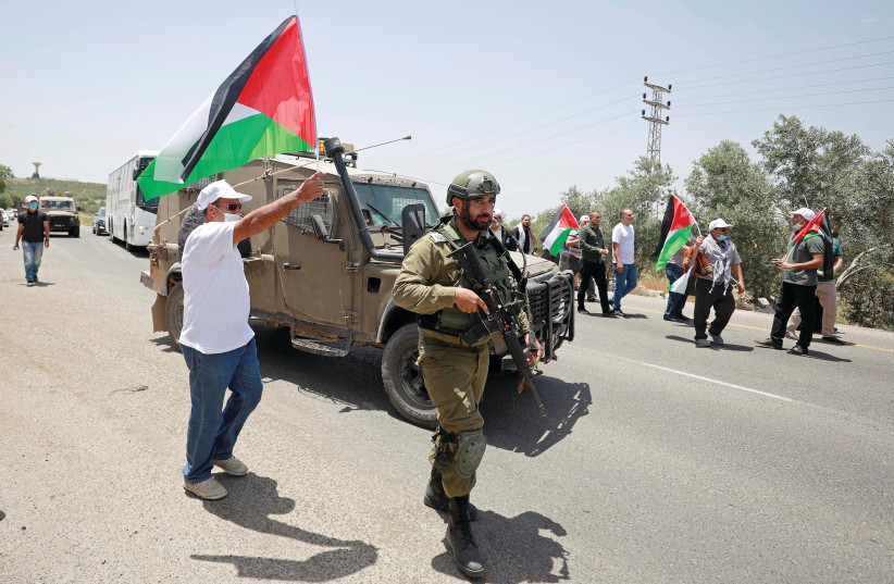 PALESTINIANS PROTEST the planned annexation. (photo credit: REUTERS)