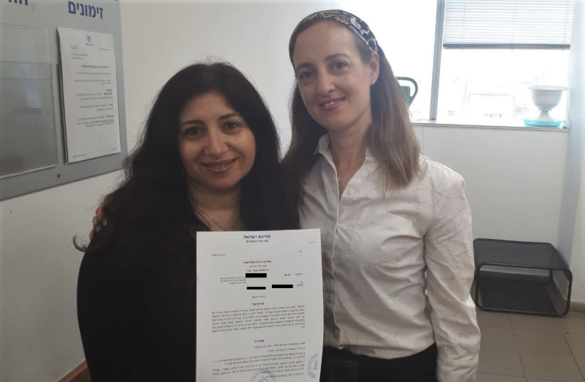 Vicky Tzur (left) is seen with attorney Tamar Oderberg holding the get. (photo credit: OHR TORAH STONE)