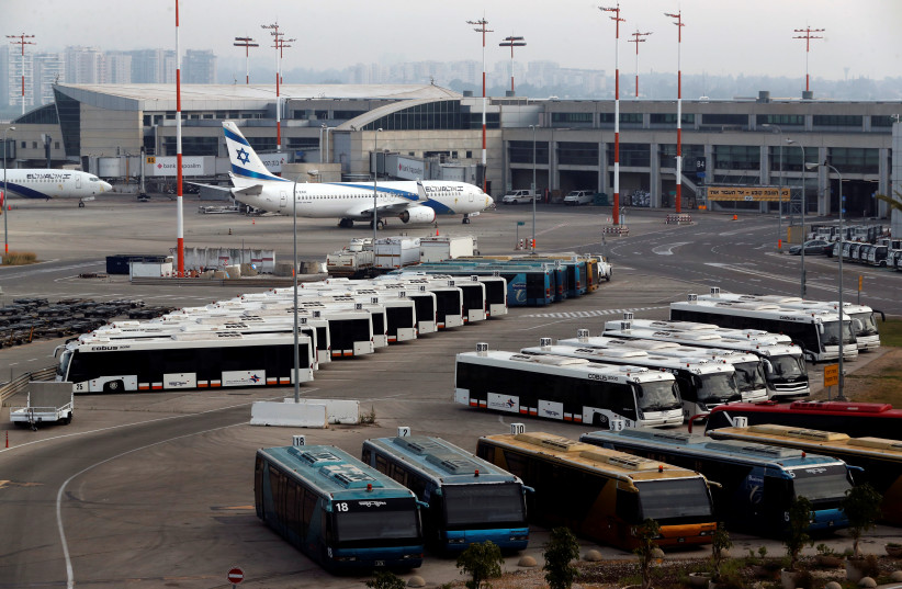 An Israeli flag carrier El Al Airlines plane is seen on the tarmac at Ben Gurion International Airport, in Lod, near Tel Aviv, Israel (photo credit: REUTERS/Ronen Zvulun)