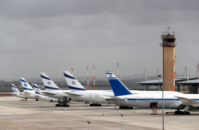 El Al Israel Airlines planes are seen on the tarmac at Ben Gurion International airport in Lod, near Tel Aviv, Israel March 10, 2020. (photo credit: REUTERS/RONEN ZEVULUN)