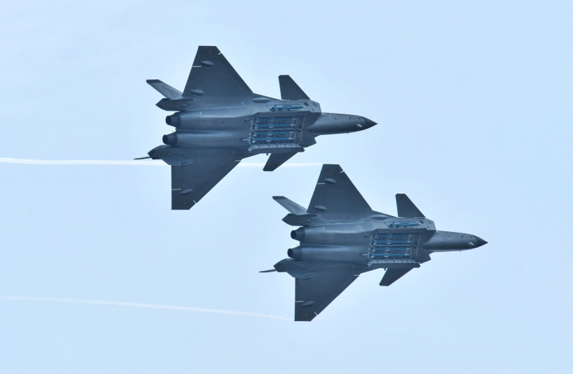 Chengdu J-20 stealth fighter jets of Chinese People's Liberation Army (PLA) Air Force perform with open weapon bays during the China International Aviation and Aerospace Exhibition, or Zhuhai Airshow, in Zhuhai, Guangdong province, China November 11, 2018. (photo credit: STRINGER/ REUTERS)