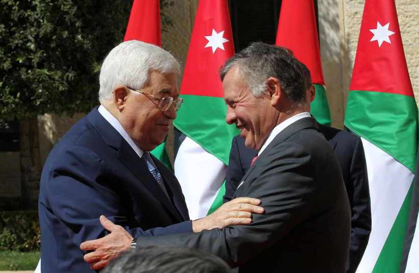 Jordan's King Abdullah meets Palestinian Authority President Mahmoud Abbas at the Royal Palace in Amman on March 12, 2018 (photo credit: REUTERS/MOHAMMAD ABU GHOSH/POOL)