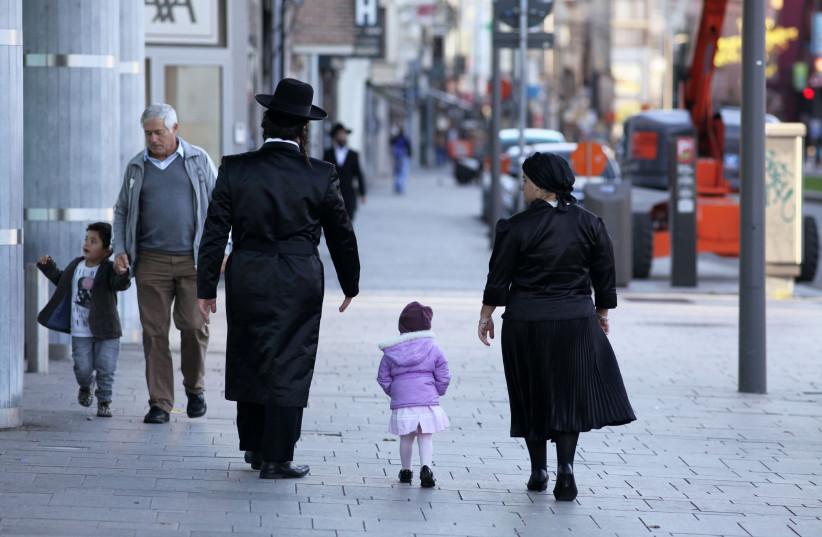 Orthodox Jews in Antwerp, Belgium, in 2012 (photo credit: ALEXANDER STEIN/ULLSTEIN BILD VIA GETTY IMAGES)