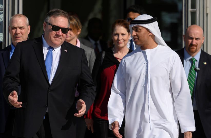 US Secretary of State Mike Pompeo speaks with the Emirati Ambassador to the US Yousef Al Otaiba at the NYU Abu Dhabi campus in Abu Dhabi, United Arab Emirates January 13, 2019 (photo credit: ANDREW CABALLERO-REYNOLDS/REUTERS)