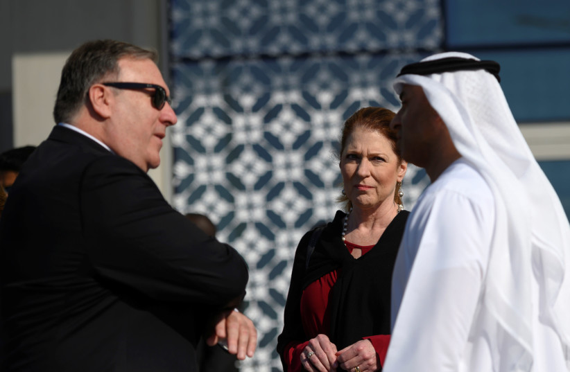 US Secretary of State Mike Pompeo and his wife Susan speak with the Emirati Ambassador to the US Yousef Al Otaiba at the NYU Abu Dhabi, United Arab Emirates January 13, 2019 (photo credit: ANDREW CABALLERO-REYNOLDS/REUTERS)