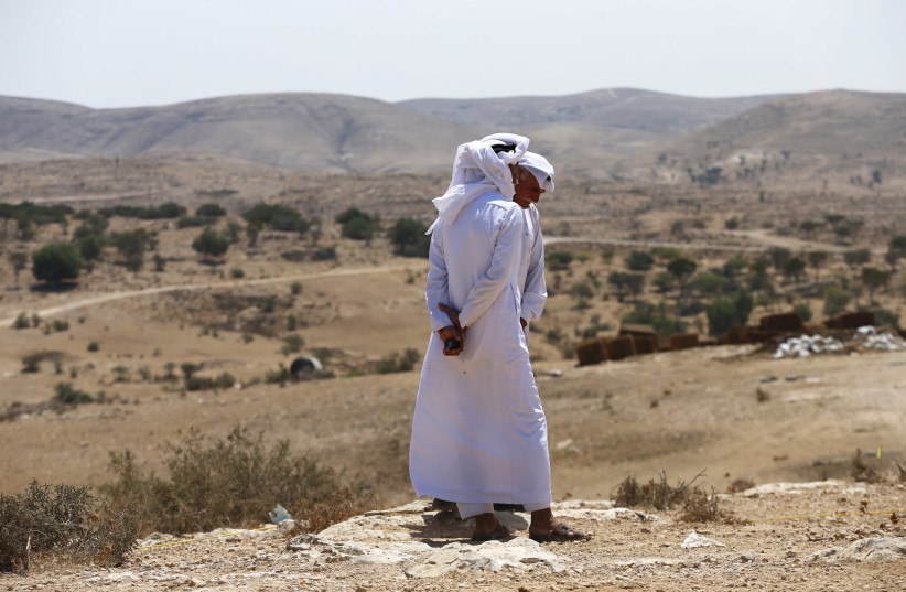 Bedouin men, residents of Umm Al-Hiran, a Bedouin village which is not recognised by the Israeli government, speak during a protest against the building of a Jewish community on the land of Umm Al-Hiran, in Israel's southern Negev desert August 27, 2015 (photo credit: REUTERS/AMMAR AWAD)