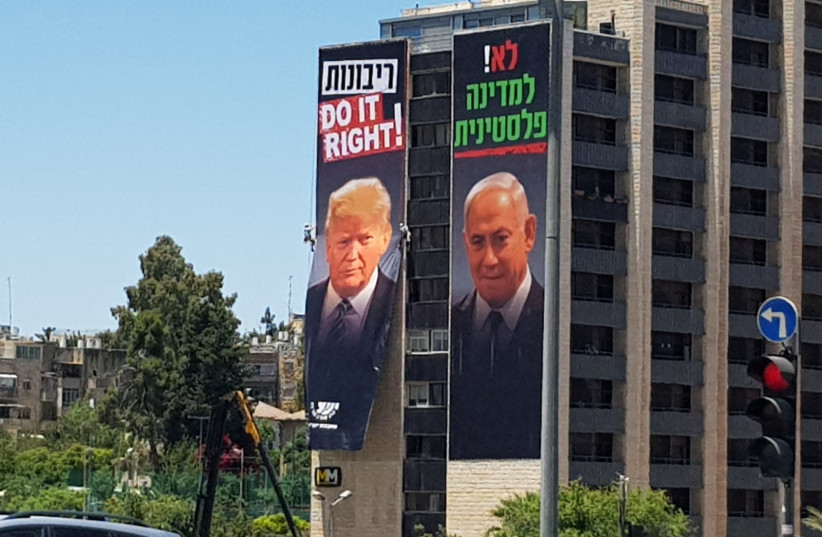 Signs abour annexation with pictures of US President Donald Trump and Prime Minister Benjamin Netanyahu are displayed in Israel (photo credit: COURTESY YESHA COUNCIL)