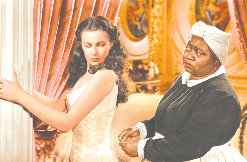 Hattie McDaniel (R) and Vivien Leigh (L) in the iconic roles of Mammy and Scarlett O'Hara in the 1939 film 'Gone with the Wind.' Her role earned McDaniel the Academy Award for Best Supporting Actress, she was the first African-American actor to win an Oscar.   (photo credit: Courtesy)