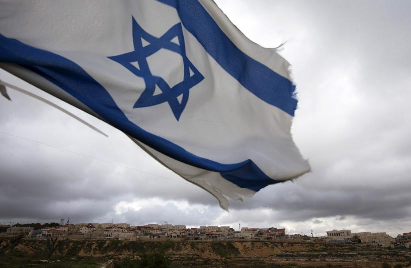 Israeli flag is seen. (photo credit: RONEN ZVULUN/REUTERS)